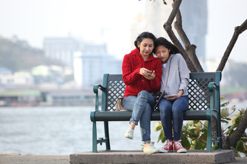 Teen with her mother listening music together with complicity