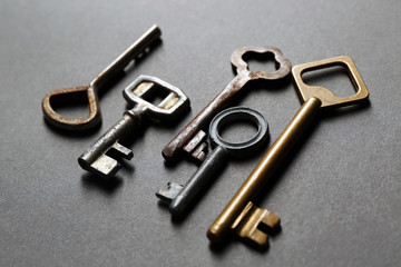 Group of old keys on grey textured background