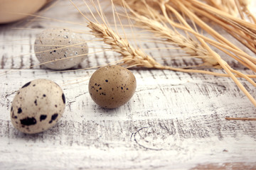 Quail eggs on rustic wooden background. Soft view.