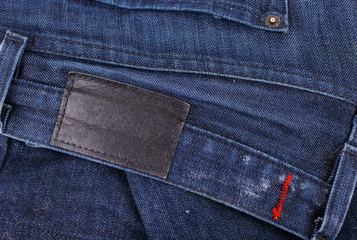 jeans closeup with blank leather label