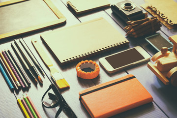 top view photo of school supplies on wooden table