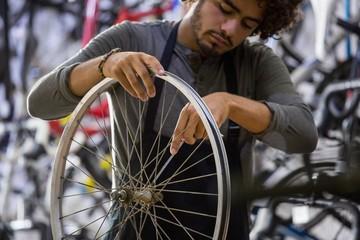 Worker repairing bicycles