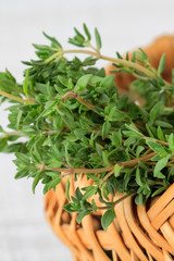 Green thyme in a basket, close up