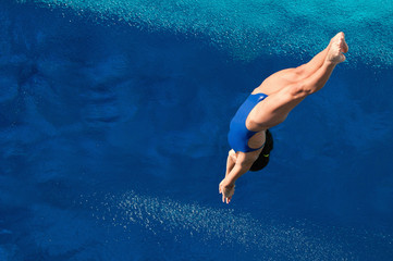 Printed roller blinds Diving Attractive female diver in the air. Shot from above