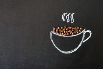 cup drawn with chalk on black board and real coffee beans