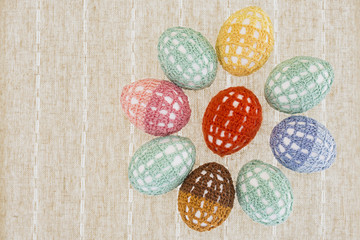 the Easter eggs dressed in lacy covers