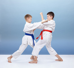 Boys are trained blocks and punches in karategi