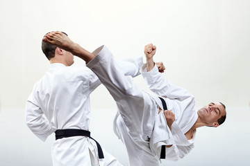 Collage of a punch arm and a kick leg in the performance of athletes