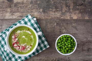 cream peas with radishes on wood