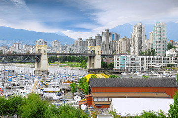 Burrard bridge, yachts and boats by Granville island.