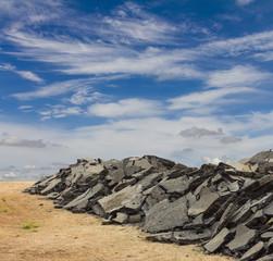 .Fragments of broken asphalt road and sky.