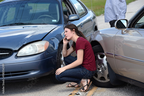 Young Woman Using Cellphone After Accident