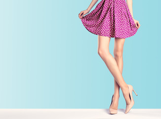 Woman legs in fashion dress and high heels, outfit