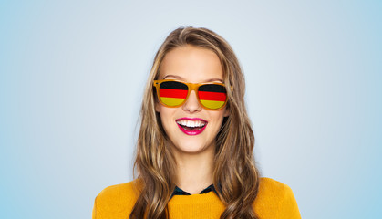happy young woman or teen girl in sunglasses