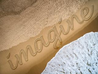 Imagine written on the beach