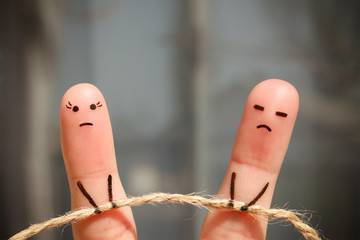 Finger art of couple. Woman and man pull rope. Couple quarreled, cannot solve the problem, a misunderstanding.