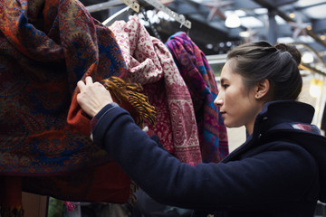 Young Woman Shopping In Covered Market