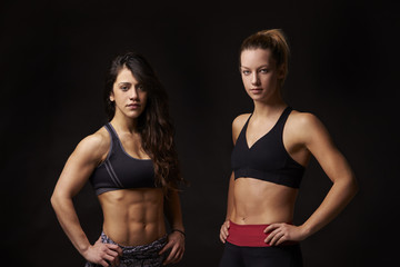Portrait of two athletic young women in sports clothing