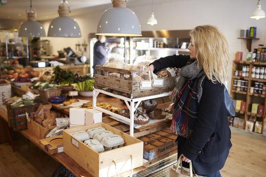 Woman Shopping For Organic Bread In Delicatessen