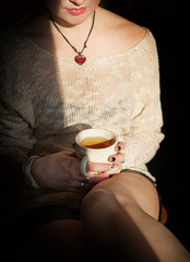 Woman relax with cup of tea in sunlight