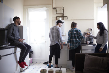 Group Of Students Hanging Out In Shared House Together