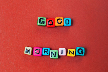 Words good morning spelled out in colorful cube beads