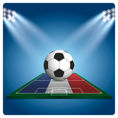 Football or soccer on france flag, with bright spotlights illumi