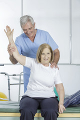 Physical therapist helps an elder patient