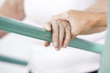 Physiotherapist helping senior woman