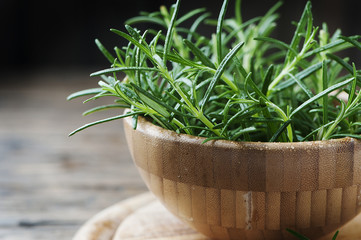 Fresh green rosemary on the wooden table
