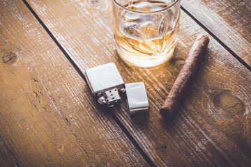 Cuban cigar and whiskey on an old wooden table