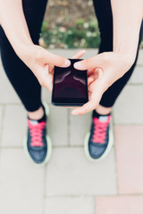 Closeup of woman using mobile phone
