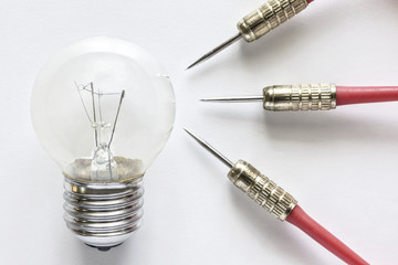 Closeup bulb lamp with three dart on white background, idea and business success concept