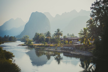 Foto auf AluDibond Reflexion Limestone hills reflected in water. Laos, Vang Vieng
