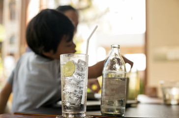 Healthy nutrition of drinking water with lemon and unidentified
