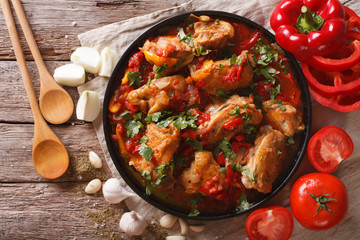 chicken stew with vegetables on a table close-up. horizontal top view