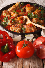 Chakhokhbili Chicken with ingredients close-up. vertical
