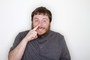 Guy with finger up his nose