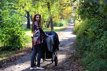 women walk stroller summer