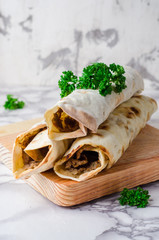 Lahmacun shape roll - turkish or arabian pizza with miced meat and spice