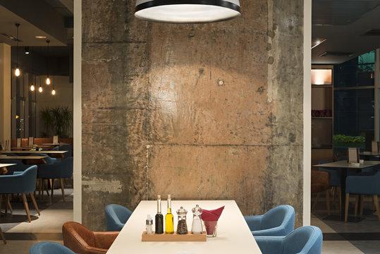Modern restaurant interior with concrete wall