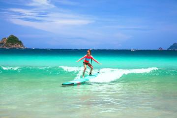 Kid surfing