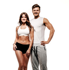 Athletic couple over white background