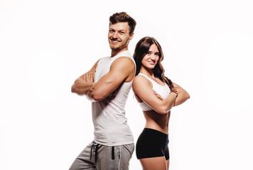 Athletic couple over white background