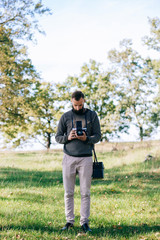 man photographer is making landscape photography with old film camera medium format