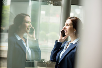 Business woman talk to cellphone at indoor