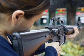 woman and gun fire
