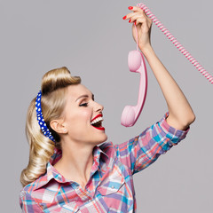young happy woman with phone, dressed in pin-up style