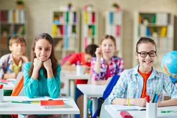 Pupils by desks