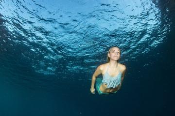 Blonde beautiful Mermaid diver underwater